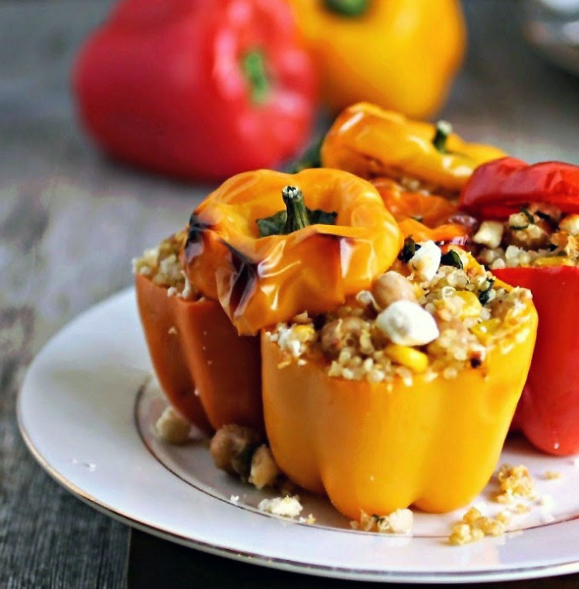 Stuffed peppers in the oven with quinoa, vegetables and cheese